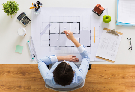 architect with compass measuring blueprint Stock Photo