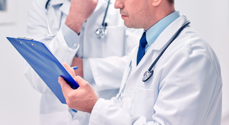 close up of doctors with clipboard at hospital Stock Photo
