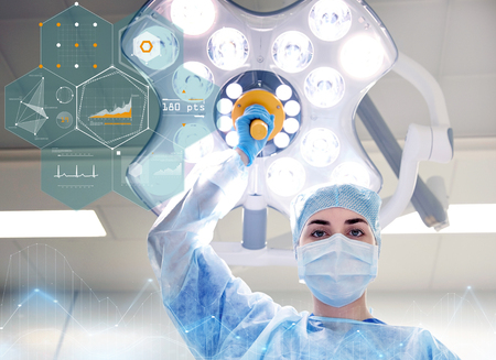 theatre masks: surgeon in operating room at hospital Stock Photo