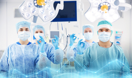 group of surgeons in operating room at hospital 스톡 콘텐츠