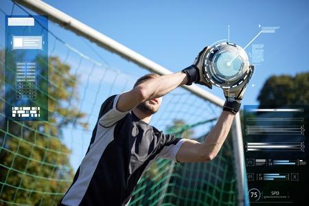 goalkeeper with ball at football goal on field Stok Fotoğraf