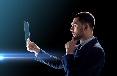 businessman working with transparent tablet pc