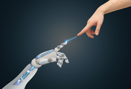 human and robot hands reaching to each other Stock Photo