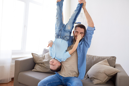 father with son playing and having fun at home Stock Photo