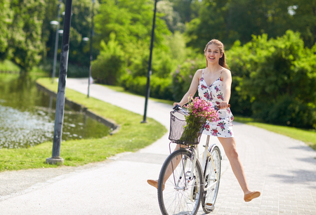 happy woman riding fixie bicycle in summer park Stock fotó - 83668321