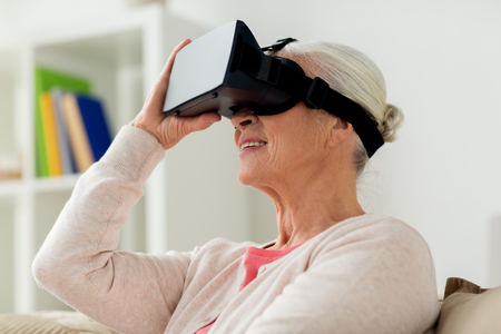 mediated: old woman in virtual reality headset or 3d glasses