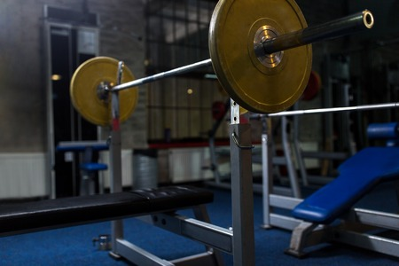 weight bench with barbell in gym Reklamní fotografie