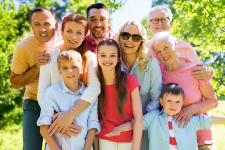 generation and people concept - happy family portrait in summer garden