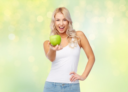happy beautiful young woman with green apple Stock Photo