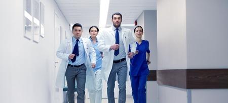 group of medics walking along hospital