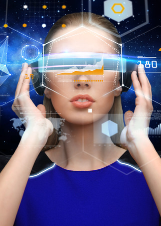 woman in virtual reality 3d glasses with charts photo