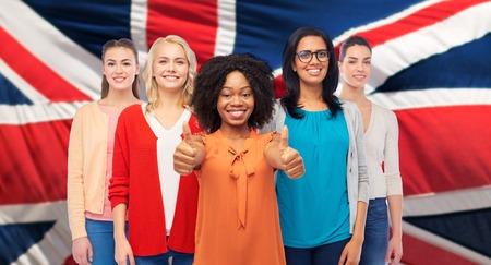 international english women showing thumbs up photo