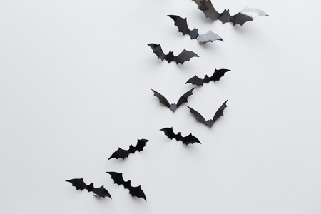 black paper bats over white background 版權商用圖片