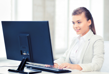 businesswoman with computer in office photo