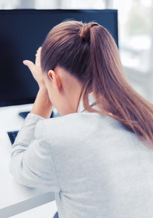 stressed woman with computer photo