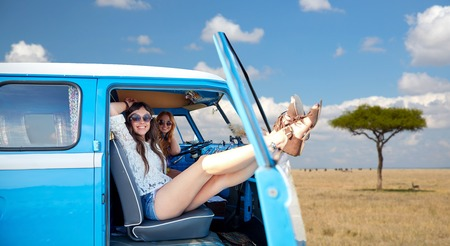 happy hippie women in minivan car in africa Stock Photo