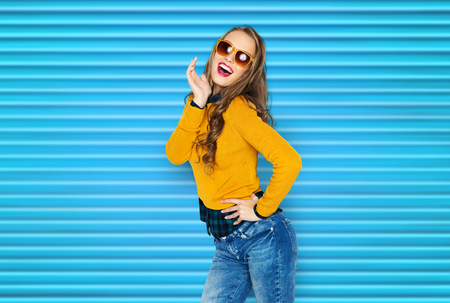 happy young woman or teen girl in casual clothes photo