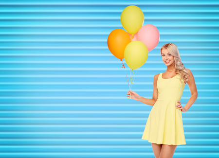 happy woman in dress with helium air balloons