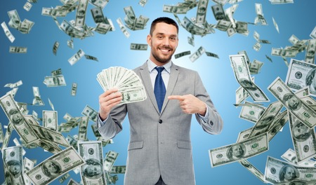 smiling businessman with american dollar money photo