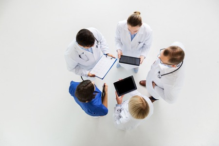 doctors with cardiogram and and tablet pc photo