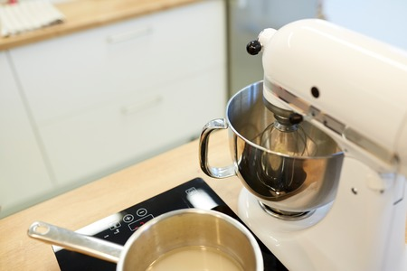 electric mixer and pot on stove at kitchen Stock fotó
