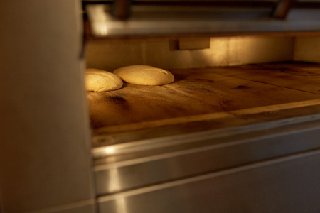 yeast bread dough in oven at bakery kitchen