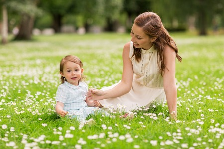 happy mother with baby girl at summer park Stock Photo