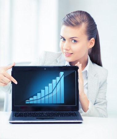 businesswoman showing laptop with graph Stock Photo