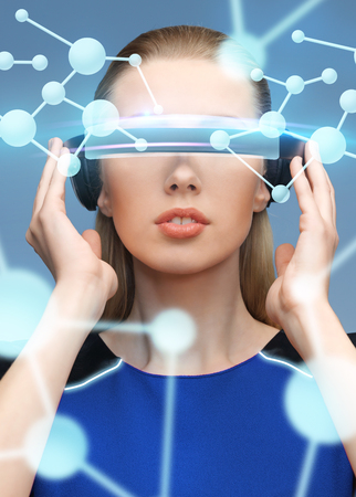 woman in virtual reality 3d glasses with molecules photo