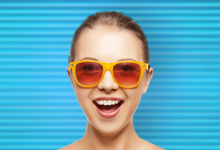 happy teenage girl or woman face in shades