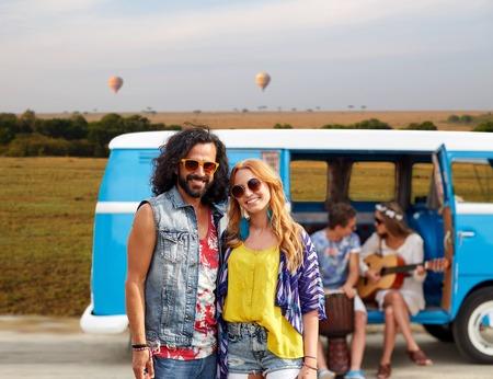 happy hippie couples and minivan in africa photo