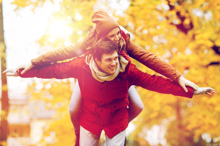 happy young couple having fun in autumn park photo