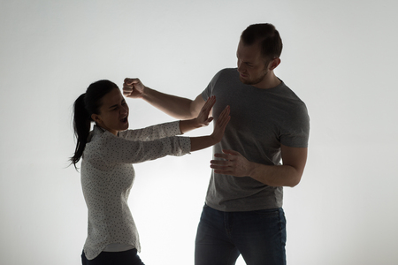 domestic violence, people and abuse concept - angry couple having fight Stock Photo