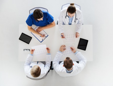 group of doctors with cardiograms at hospital photo