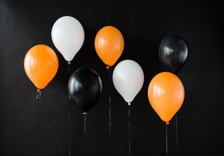 holidays, decoration and party concept - bunch of air balloons for halloween or birthday over black background Stok Fotoğraf