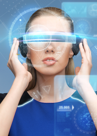 woman in virtual reality 3d glasses with screens photo