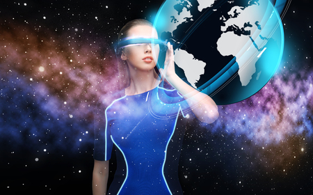 woman in virtual reality 3d glasses with earth photo
