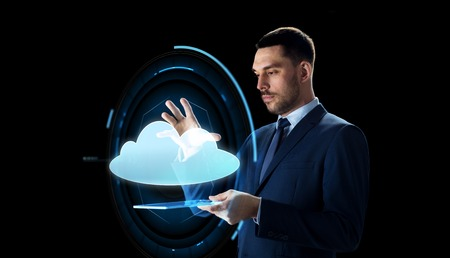 businessman with tablet pc and cloud projection Stock fotó