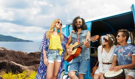 hippie friends playing music at minivan on island