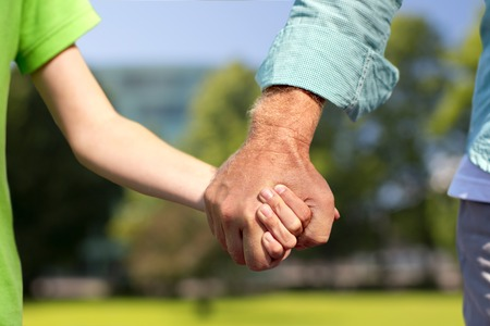 senior man and child holding hands Stock Photo