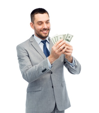 smiling businessman counting american dollar money photo