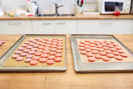 macaroons on oven trays at confectionery