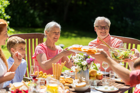 happy family having dinner or summer garden party Stock Photo