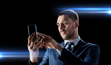 businessman with transparent smartphone