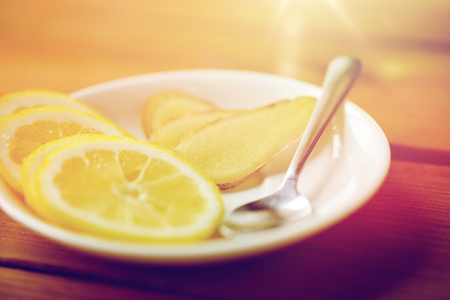 lemon and ginger on plate with spoon