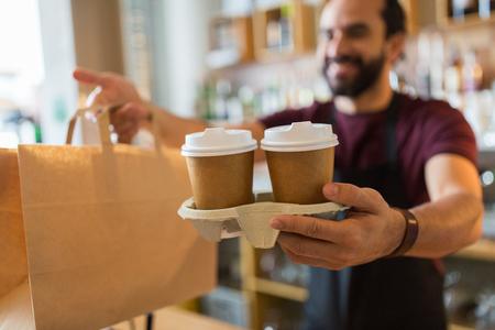 man or bartender serving customer at coffee shop 免版税图像 - 84758573