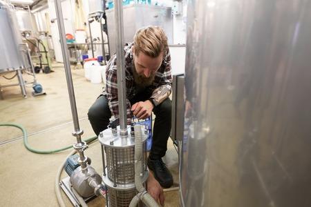 man working at craft beer brewery