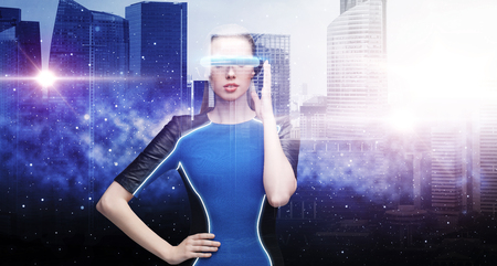 woman in virtual reality glasses over space city 版權商用圖片