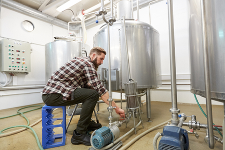 man working at craft beer brewery