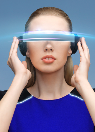 virtual reality, science, technology and people concept - beautiful woman in futuristic 3d glasses over blue background